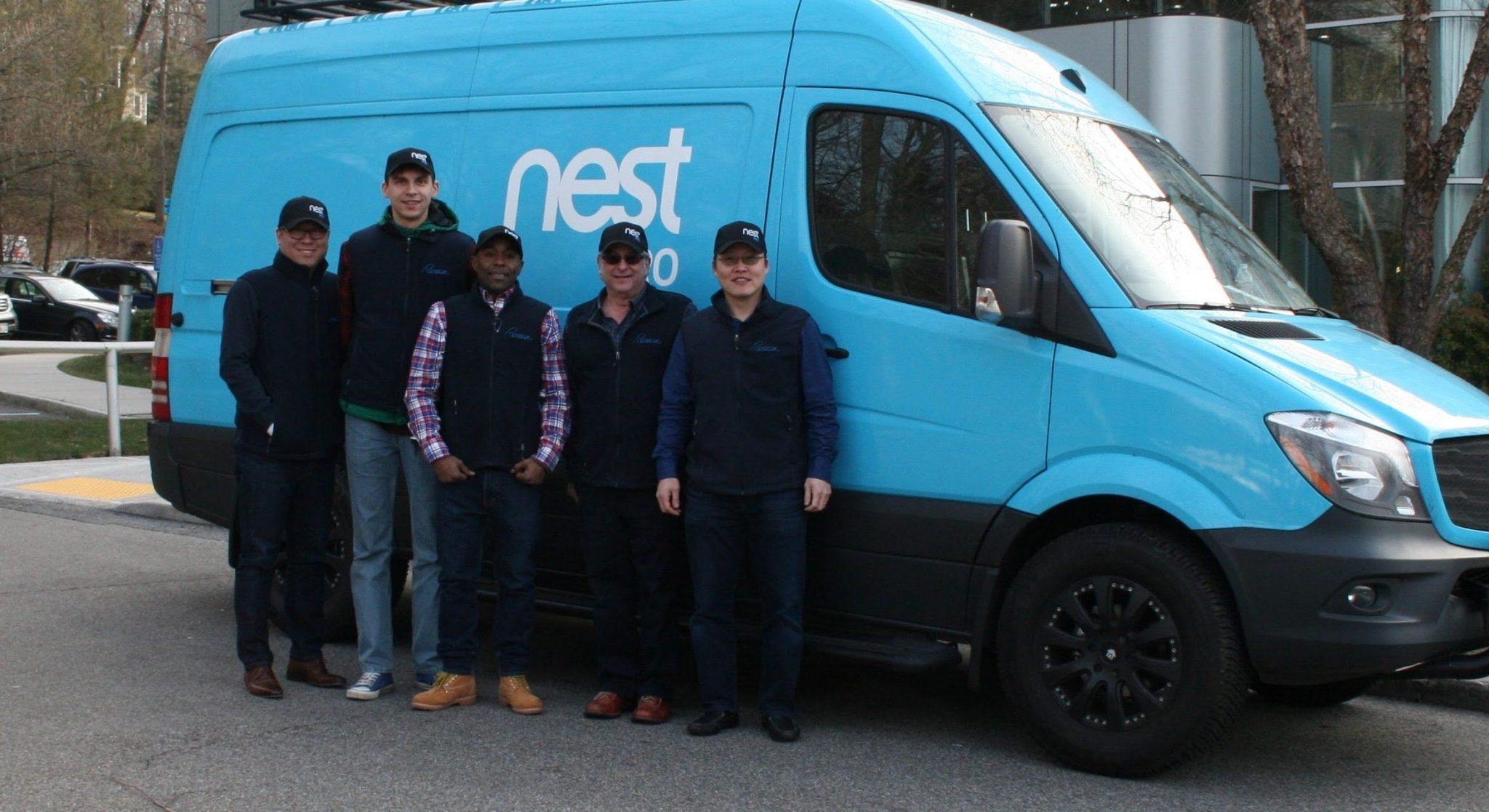 DonHam HVAC contractors team in front of Nest Van